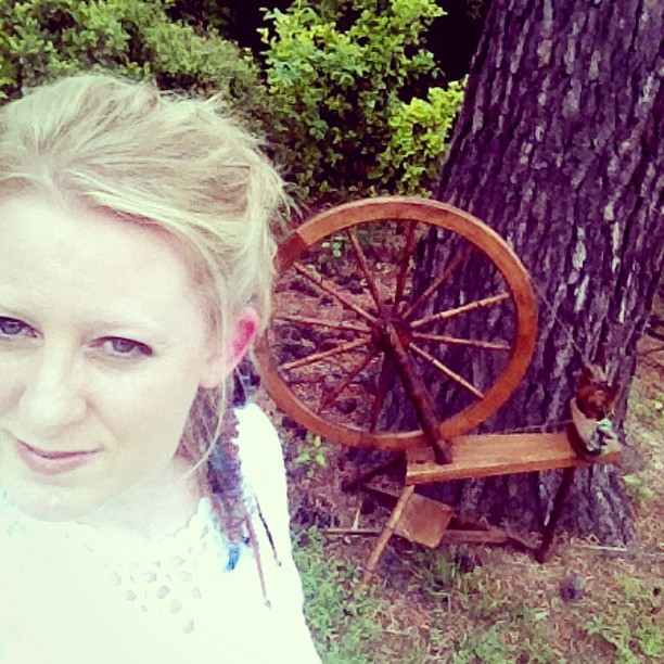Cyndi Minister owner of The Twisted Purl Fiber Artist with Spinning Wheel