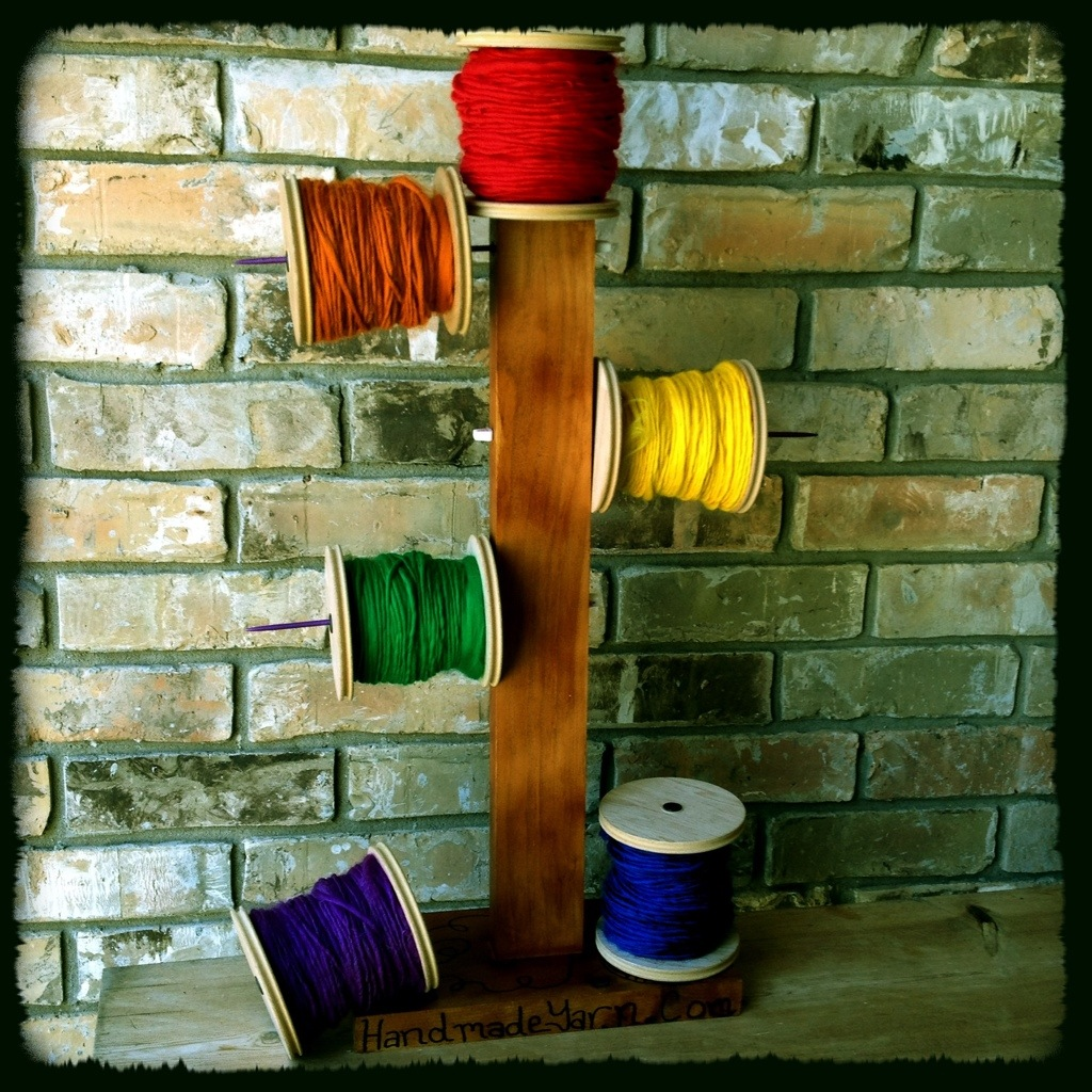 Rainbow Handspun Yarn on Bobbin