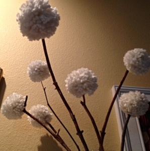 Yarn on Pom Poms on sticks