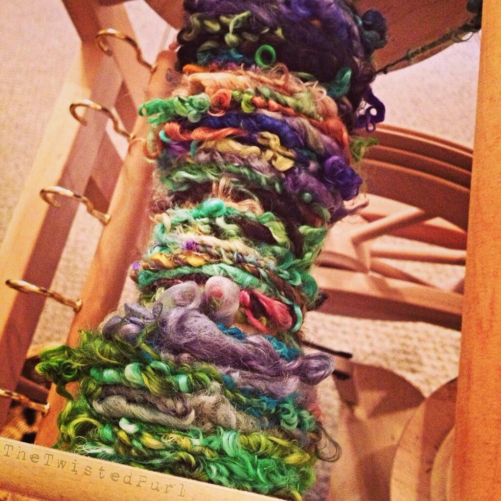 Fiber on Wheel being turning into yarn