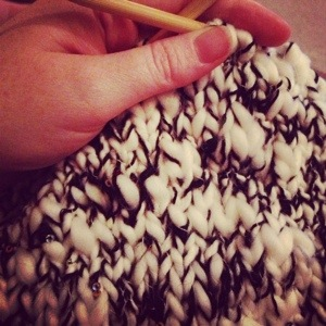 Black and White Yarn on the Knitting Needles