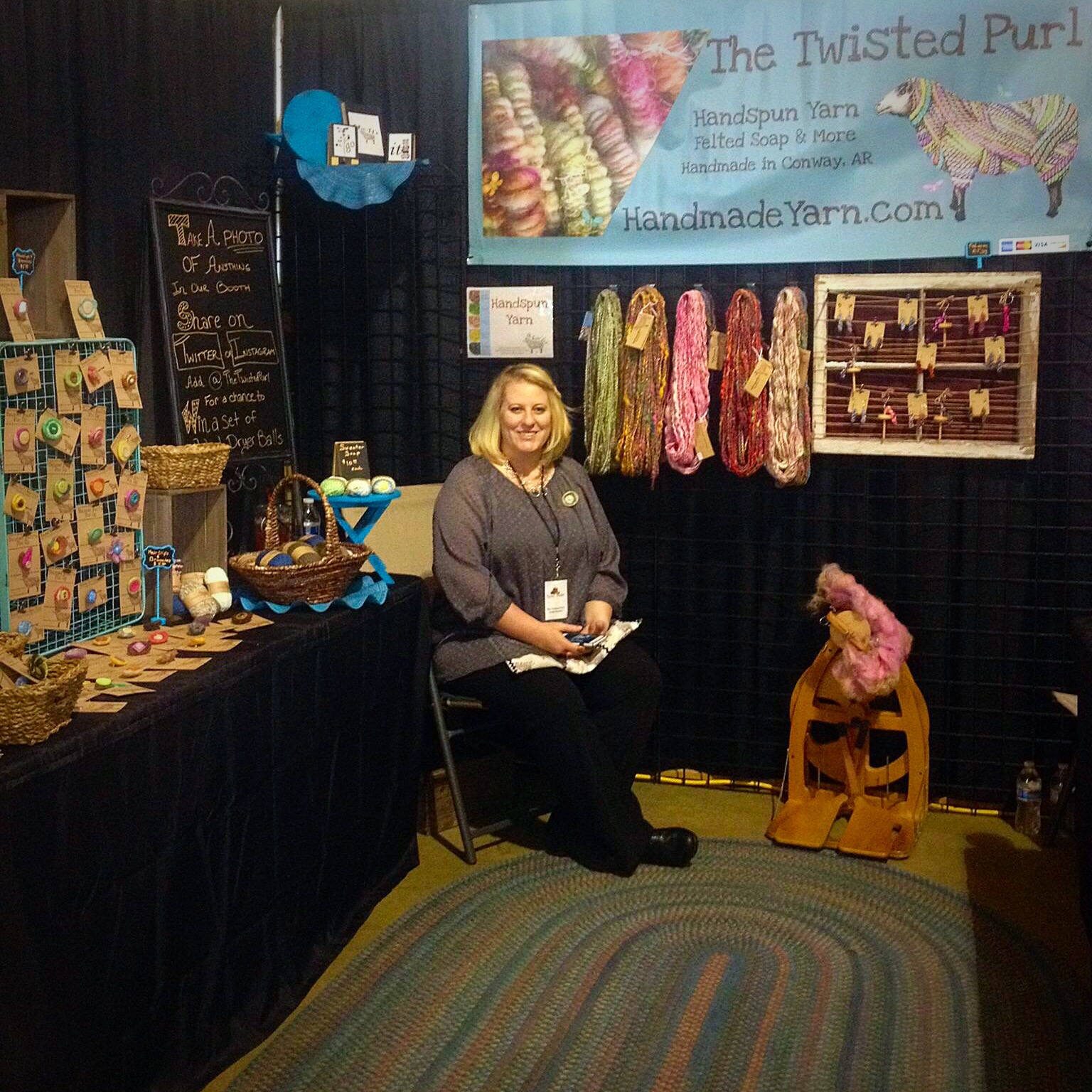 Cyndi Minister sitting in Twisted Purl Booth